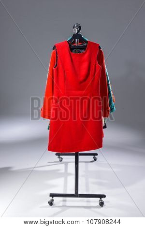 Variety of different clothes for females rack display-light background