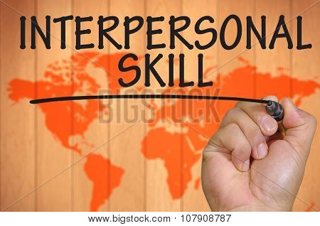 Hand Writing Interpersonal Skill Over Blur World Background