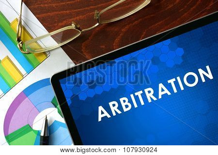 Tablet with arbitration on a table.