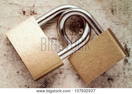 Two linked padlocks symbolizing good relationships or marriage poster