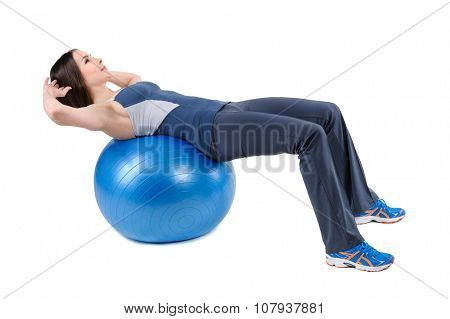 Young woman shows starting position of Abdominal Fitball Workout, isolated on white poster
