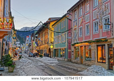 GARMISCH-PARTENKIRCHEN GERMANY - JANUARY 06 2015: Christmas mood in Garmisch-Partenkirchen Germany. Streets of the town illuminated and decorated for the winter holidays