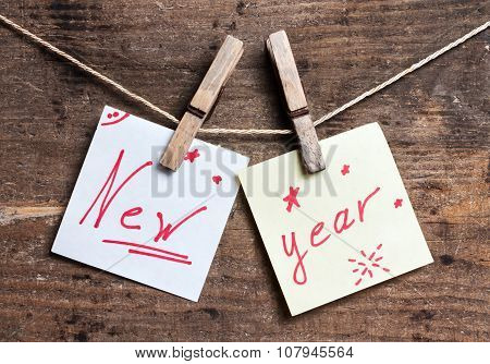 New Year card on wooden surface