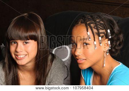 cute African American girl and Caucasian girl friend