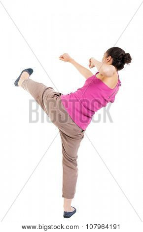 skinny woman funny fights waving his arms and legs. Rear view people collection.  backside view of person.  Isolated over white background. African-American smashes right foot.