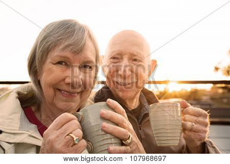 Cheerful Couple With Coffee Outdoors