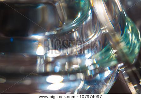 Thick glass abstraction made with glass vase and glass on shallow depth of field. poster