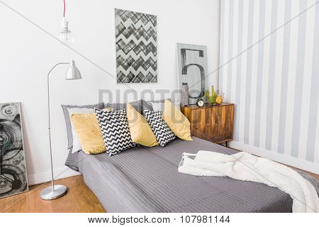Matrimonial Bed With Grey Bedding
