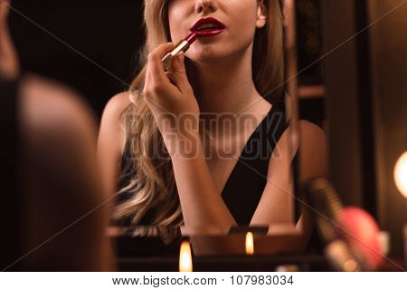 Flirtatious Female Using Red Lipstick