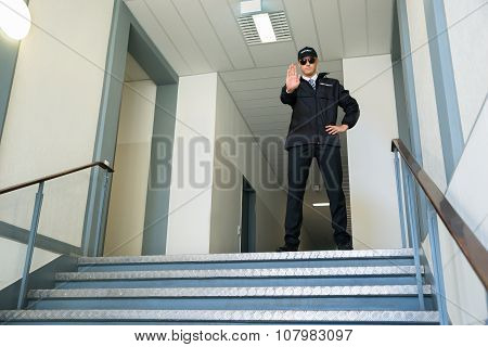Security Guard Making Stop Gesture
