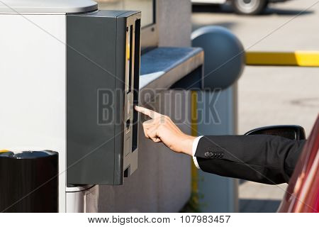Person Using Parking Machine To Pay For Parking