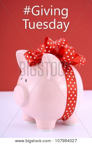 Gift Wrapped Piggy Bank On Red White Background.