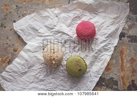 Overhead View Of Three Yummy Macaroons On Crumpled Paper