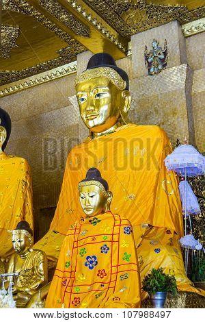 RANGOON, MYANMAR - JUNE 3, 2014: Kakusandha buddha image covered with foil gold