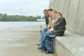 happy Family at river embankment in autumn poster