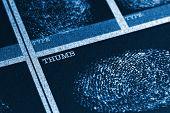 Concept image of a fingerprint file, thumb closeup poster
