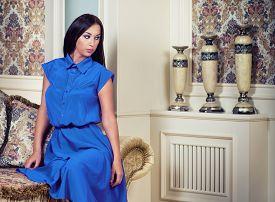 Woman In Blue Dress In Luxury Interior.
