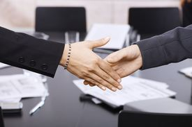 Businesswomen Handshake Over Table
