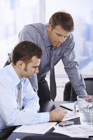 Businessmen At Work