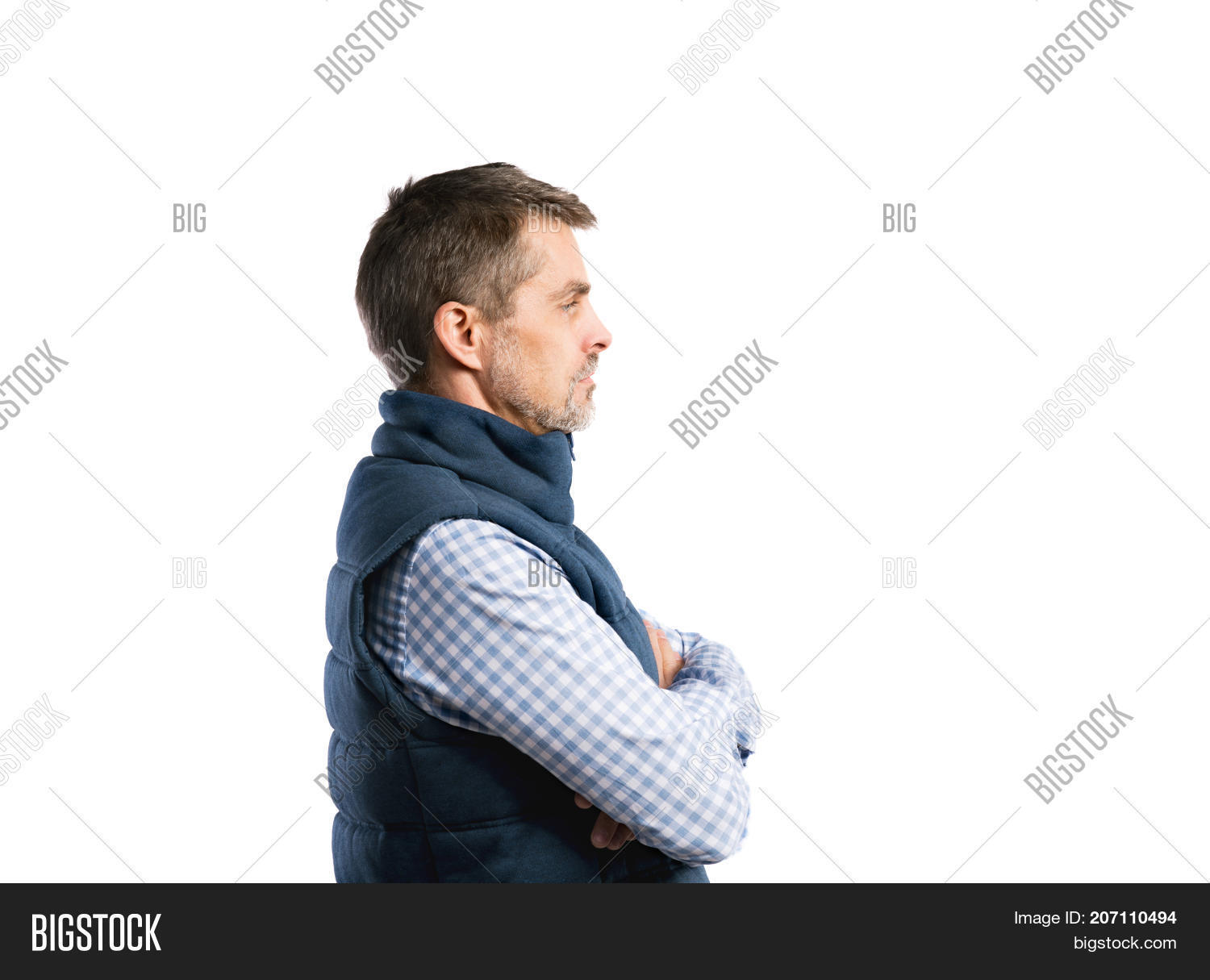 9a9614c8813 Mature handsome hipster man in blue checked shirt and winter vest