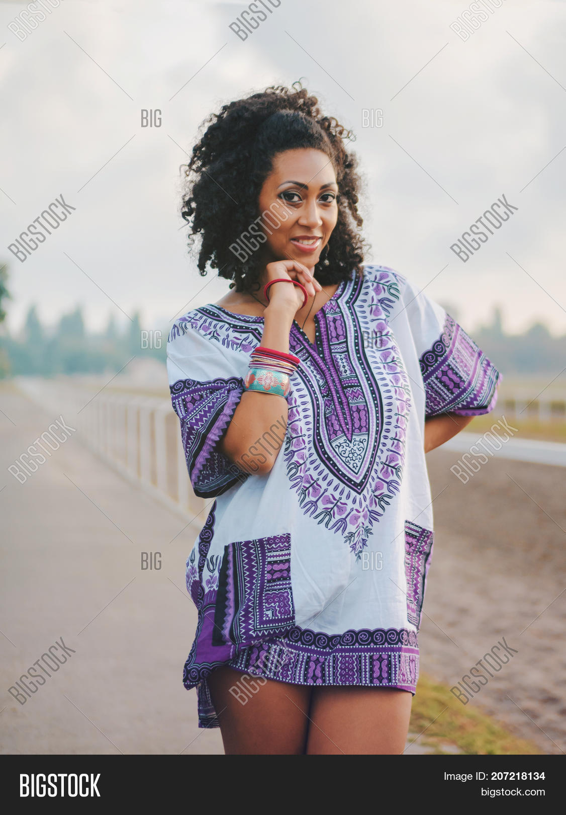 a5a06de025f Happy beautiful afro-american woman outdoor. Young mixed race carefree girl  wearing colorful clothing