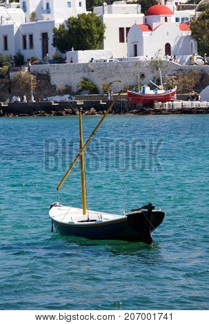 Lonely sailboat bobbing in the cove off the island of Mykanos, Greece.