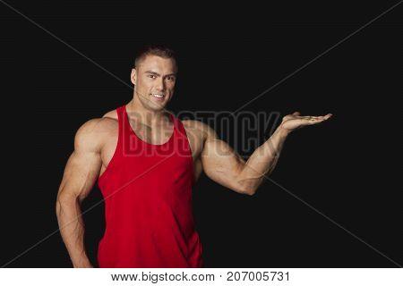 Portrait of a Muscular Handsome Man on Black Background