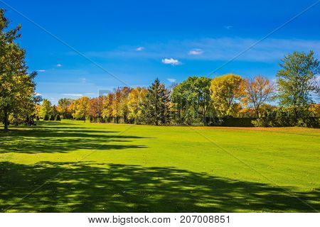 Concept Golf tourism. Phenomenally beautiful park with red, orange and green autumn foliage. Golf Club on the way to Bromont, the French Canada