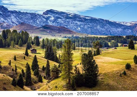 Well-known international ski resort in the fall. The Alps di Siusi. Concept of active and ecological tourism. Jagged rocks around the Dolomites mountain valley