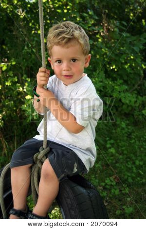 Little Boy On Tire Swing