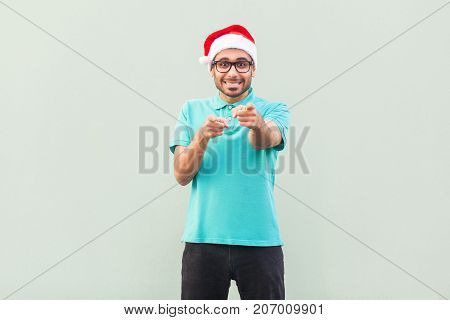 Hey You! Its Christmas Man! Bearded Man In Santa Hat And Glasses, Pointing Finger And Looking At Cam