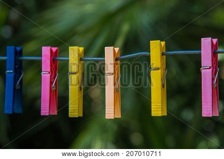 Colored clothespins for hanging out in the shoes