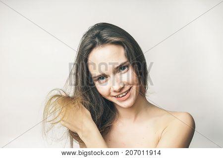 girl shows the hair ends, heath care,beauty face