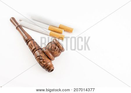 Pipe And Cigarettes.