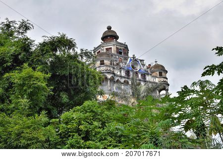 The Kaiping Diaolou (watchtowers) in Guangdong province in China are fortified multi-storey towers served mainly as protection against forays by bandits, a few of them also served as living quarters.