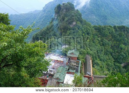 The Wudang MountainsHubei China. Many Taoist monasteries to be found thereIt's world heritate and famous in one of China. Good weather sometime it a lot of the fog. And It's especially name.