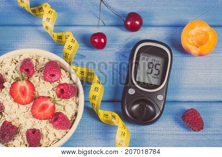 Glucose Meter, Oatmeal With Fruits And Centimeter, Concept Of Checking Sugar Level, Diabetes And Hea
