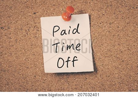 paid time off message on a cork board