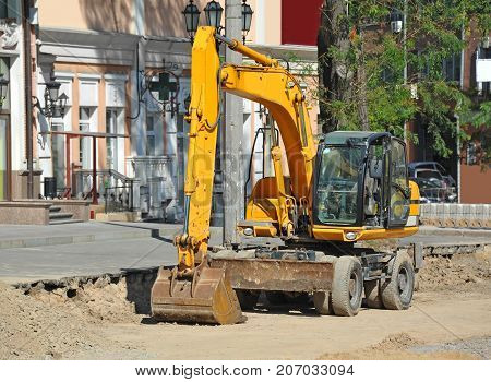 Excavating Machine On Road Site