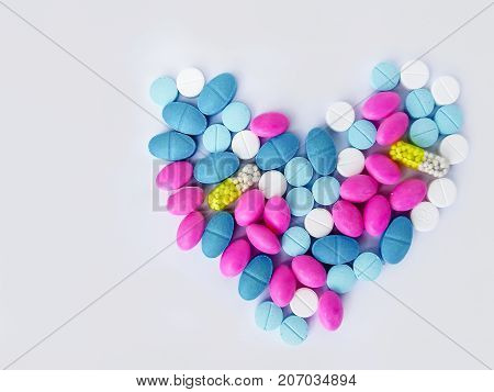 Pile of scattered capsules on a white background. capsules isolated white capsule pharmacy bottle pill drug concep