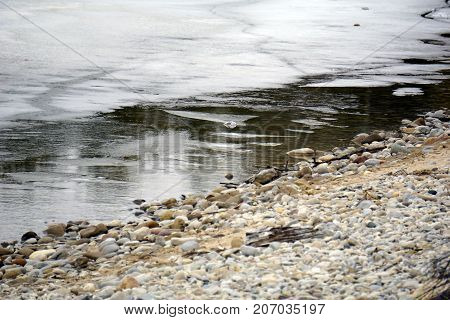 The ice melts along the shore of Little Traverse Bay, near Bay View, Michigan, during March.