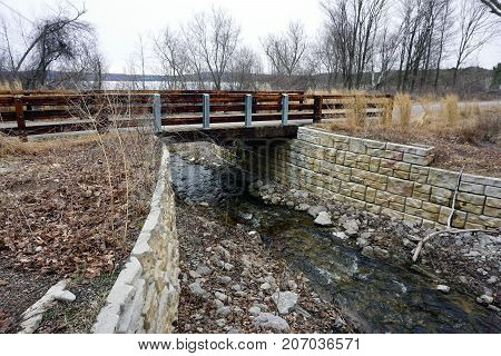 A bridge, along the Little Traverse Wheelway, which connects Charlevoix, Petoskey and Harbor Springs, Michigan, allows hikers and bicyclists to cross Tannery Creek.