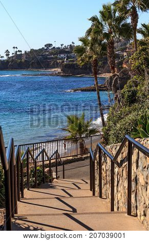 Steps leading down to Heisler Park above the ocean in Laguna Beach California in fall.