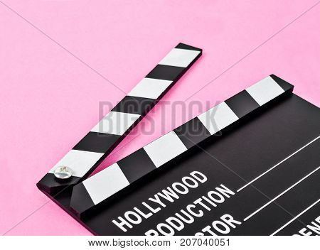 Blank movie production clapper board or slate film over pink background with copy space.