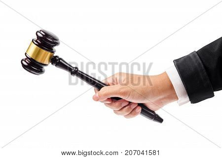 wooden gavel in hand isolated on white background Save clipping path.