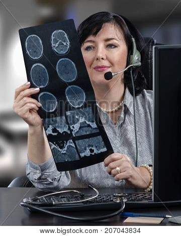 Vertical portrait of remote medical female consultant with x ray image of brain