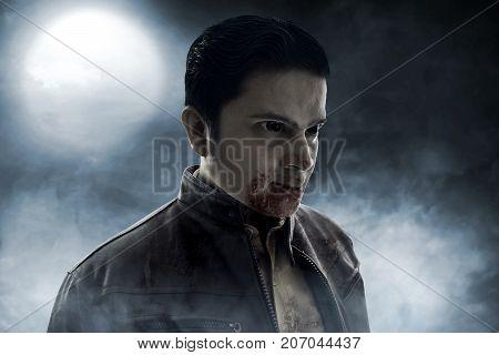 Angry vampire on smoke background at night
