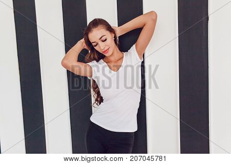 Woman with a big breast in a white T-shirt. Mock-up.