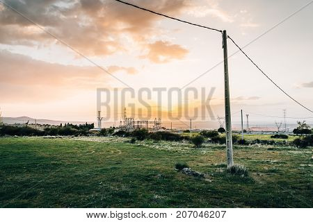 Electrical Power Lines and Pylons in the countryside at sunset