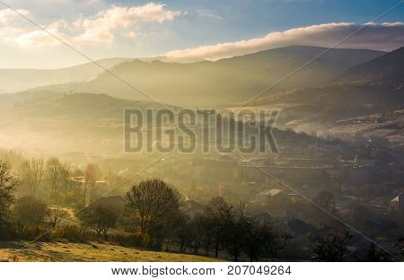 Foggy Sunrise Over The Village In Valley